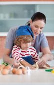 Little boy baking with his mother — Stock Photo