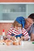 Young sweet child baking — Stock Photo