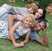 Affectionate young family in the sunshine — Stock Photo