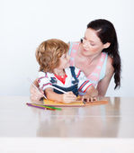 Radiant mother and son looking in each other faces — Stock Photo