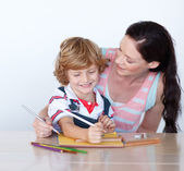 Mother and her son drawing — Stock Photo
