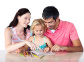 Father and mother reading with her daughter — Stock Photo