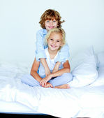 Brother embracing his siter in bed — Stock Photo