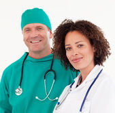Portrait of a beautiful nurse with a surgeon — Foto de Stock