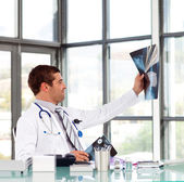 Confident doctor in his office — Stock Photo