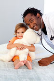 Caring young doctor with cute girl — Stock Photo
