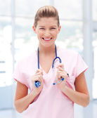 Portrait of a young doctor smiling at camera — Stock Photo