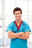 Portrait of a confident doctor in blue scrubs — Stock Photo