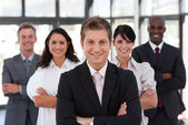 Cute business team looking at the camera — Stock Photo