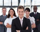 Happy business team looking at the camera — Stock Photo