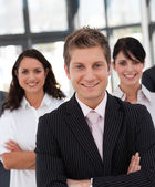 Young business team looking at the camera — Stock Photo