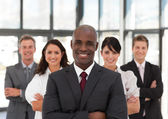 Smiling confident business team looking at the camera — Stock Photo