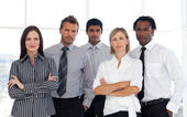Portrait of a confident group of business looking at the — Stock Photo
