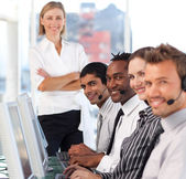 Jolly manager leading her representative team — Stock Photo