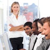 Blond manager leading her representative team — Stock Photo