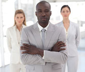 Self-assured afro-american manager with his team — Stock Photo