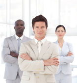 Self-assured young manager with his team — Stock Photo