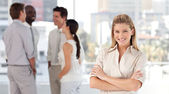 Multi-ethnic talking together at work — Stock Photo