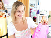 Bright woman selecting item — Stock Photo