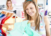 Happy woman selecting item — Stock Photo