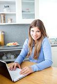 Positve woman with a laptop — Stock Photo