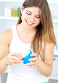 Jolly woman using cream — Stock Photo