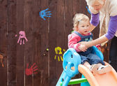 Little girl and her mother having fun with a chute — Stock Photo