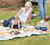 Mother and daughters having a picnic together — Stock Photo