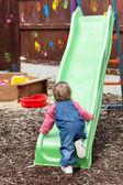 Little girl having fun with a chute — Stock Photo