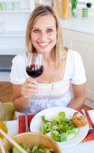 Smiling woman with a glass of wine — Stock Photo