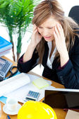 Stressed businesswoman having a headache — Stock Photo