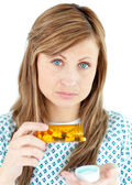 Diseased woman taking pills — Stock Photo