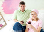 Delighted couple having free time together with a glass of wine — Stock Photo