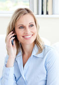 Captivating businesswoman using a mobile phone — Stock Photo