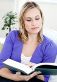 Concentrated young woman reading a book — Stock Photo