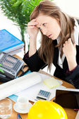 Stressed businesswoman sitting in her office in front of the tab — Stock Photo