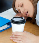 Languorous woman sleeping on table in office — Stock Photo