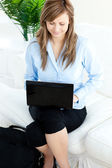Smilling woman sitting at home and working — Stok fotoğraf