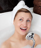 Jolly young woman having a bath — Stock Photo
