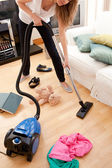 Blond young woman cleaning the living-room — Stock Photo
