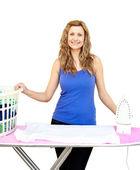 Beautiful woman behind an ironing board — 图库照片