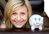 Portrait of a handsome woman with a piggybank — Stock Photo