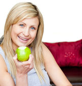 Joyful woman eating an apple — Stock Photo