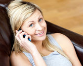 Lively woman using a phone — Stock Photo
