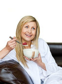 Attractive woman having a breakfast — Stock Photo