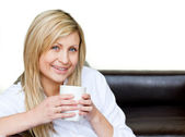 Self-assured woman holding a cup of coffee — Stock Photo