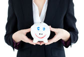 Close-up of a businesswoman holding a piggybank — Stock Photo