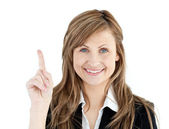 Cheerful businesswoman pointing upward isolated — Stock Photo