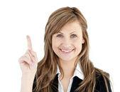 Cheerful businesswoman pointing upward isolated — Stock Photo