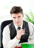 Portait of a self-assured businessman holding glasses — Stock Photo